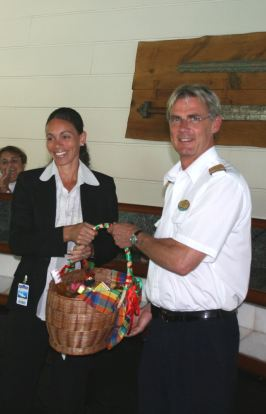 keira_aird_presents_gift_to_legend_of_the_seas_captain.jpg