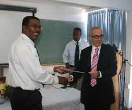 canadian_high_commissioner_hands_over_cheque_march_2008.jpg