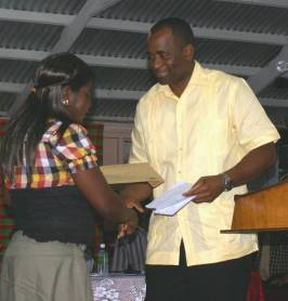 pm_skerrit_presents_cheque_to_tete_morne_village_council_may_2009.jpg