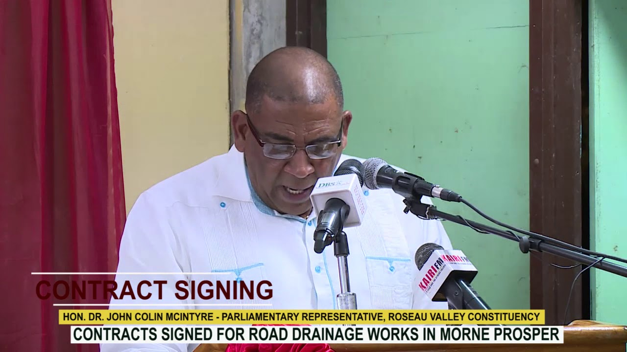 HON. DR. JOHN COLIN MCINTYRE ADDRESSES CONTRACT SIGNING CEREMONY IN MORNE PROSPER 4
