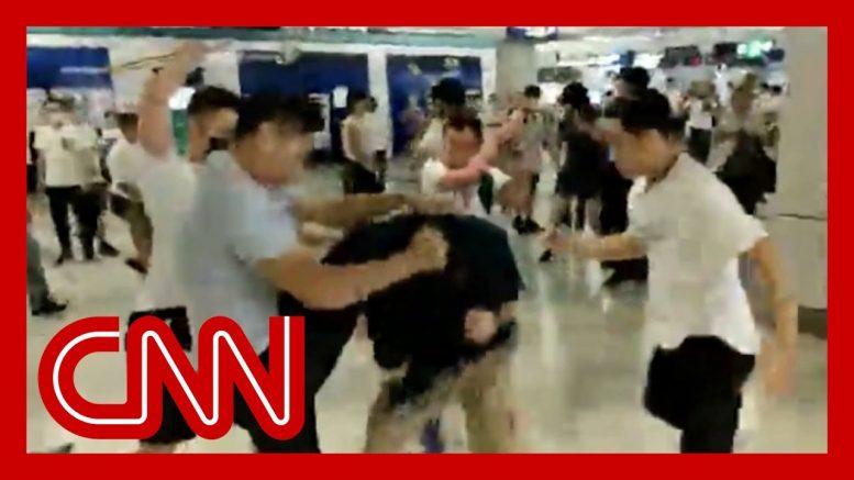Gang attacks riders on Hong Kong subway 1