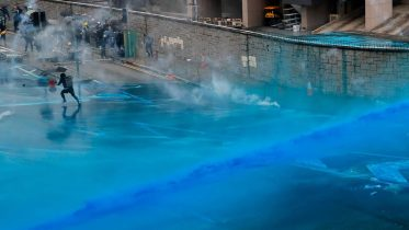 Hong Kong police spray protesters with blue-dye water cannons 1