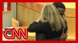 See victim's brother hug convicted ex-cop Amber Guyger 1