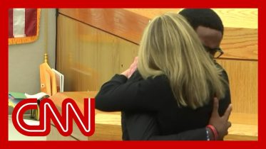 See victim's brother hug convicted ex-cop Amber Guyger 10