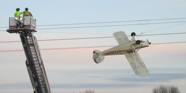 Minnesota pilot rescued after plane gets entangled in power lines, dangles in mid-air 2